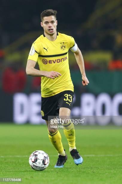 Julian Weigl of Borussia Dortmund controls the ball during the DFB Cup match between Borussia Dortmund and Werder Bremen at Signal Iduna Park on...