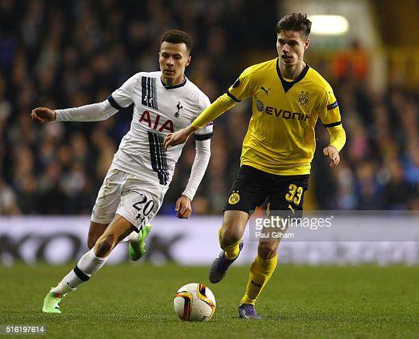Julian Weigl of Borussia Dortmund is chased by Dele Alli of Tottenham Hotspur during the UEFA Europa League round of 16 second leg match between...