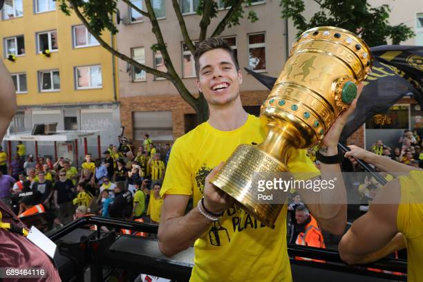 Julian Weigl of Borussia Dortmund lifts the DFB Cup trophy as the team celebrates during a winner's parade at Borsigplatz on May 28 2017 in Dortmund...