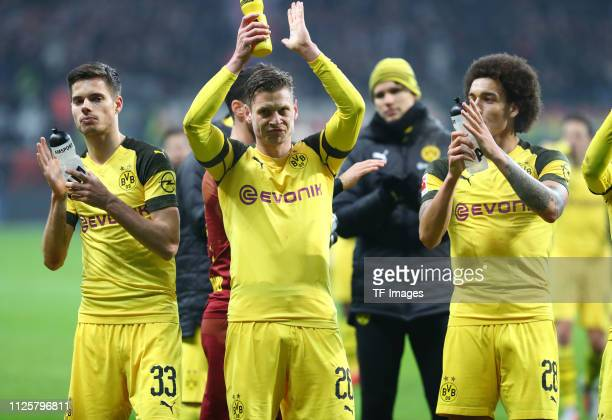 Julian Weigl of Borussia Dortmund Lukasz Piszczek of Borussia Dortmund and Axel Witsel of Borussia Dortmund acknowlege the fans after the Bundesliga...