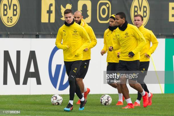 Julian Weigl of Borussia Dortmund Mahmound Dahoud of Borussia Dortmund Manuel Akanji of Borussia Dortmund and Mario Goetze of Borussia Dortmund run...