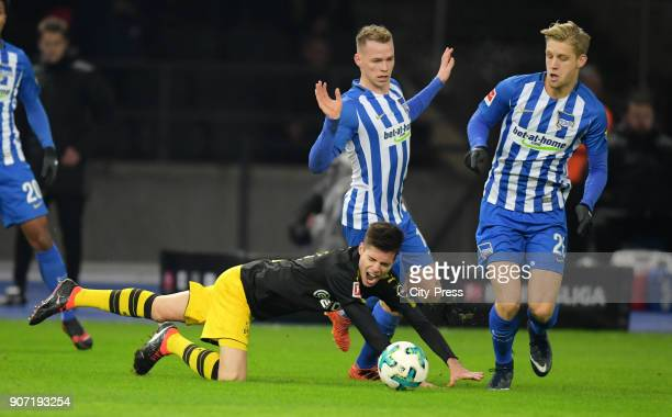 Julian Weigl of Borussia Dortmund Ondrej Duda and Arne Maier of Hertha BSC during the Bundesliga match between Hertha BSC and Borussia Dortmund at...