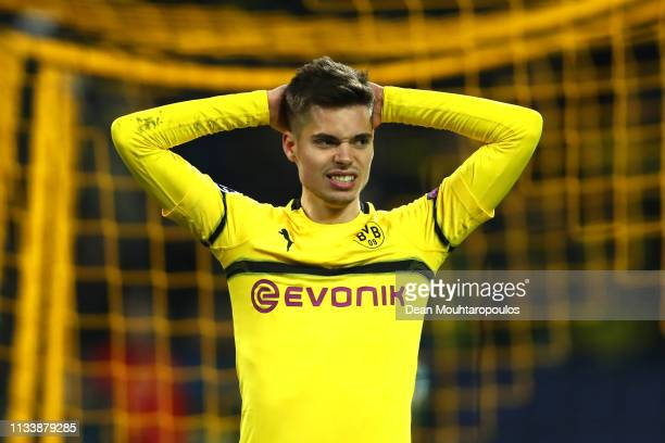 Julian Weigl of Borussia Dortmund reacts to a missed chance during the UEFA Champions League Round of 16 Second Leg match between Borussia Dortmund...