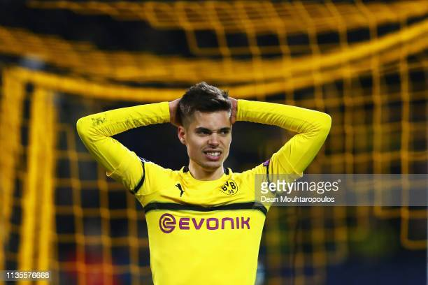 Julian Weigl of Borussia Dortmund reacts to a missed chance on goal during the UEFA Champions League Round of 16 Second Leg match between Borussia...