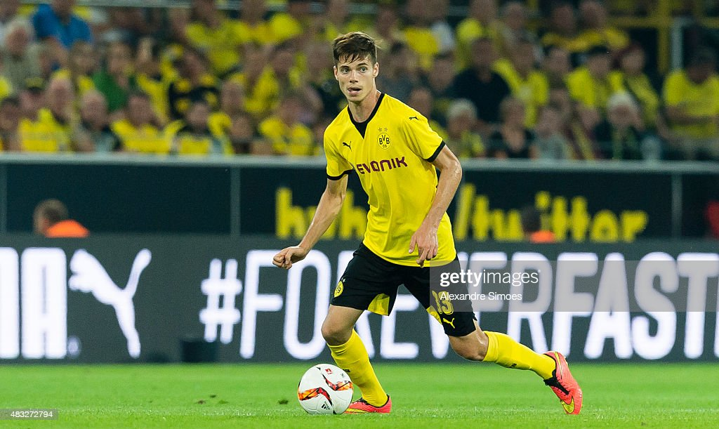Julian Weigl of Borussia Dortmund runs with the ball during the UEFA Europa League: Third Qualifying Round 2nd Leg match between Borussia Dortmund and Wolfsberg at Signal Iduna Park on August 06, 2015 in Dortmund, Germany.