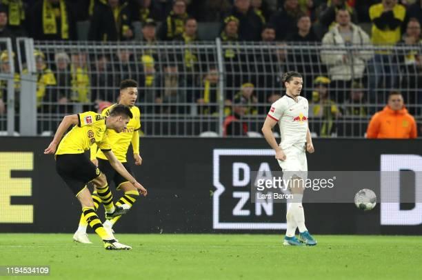 Julian Weigl of Borussia Dortmund scores his team's first goal during the Bundesliga match between Borussia Dortmund and RB Leipzig at Signal Iduna...