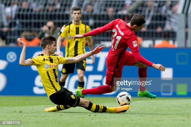 Julian Weigl of Dortmund and Branimir Hrgota of Frankfurt battle for the ball during the Bundesliga match between Borussia Dortmund and Eintracht...