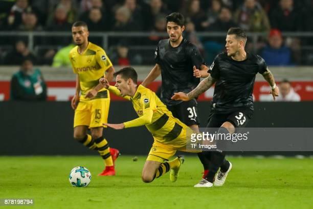 Julian Weigl of Dortmund and Daniel Ginczek of Stuttgart battle for the ball during the Bundesliga match between VfB Stuttgart and Borussia Dortmund...