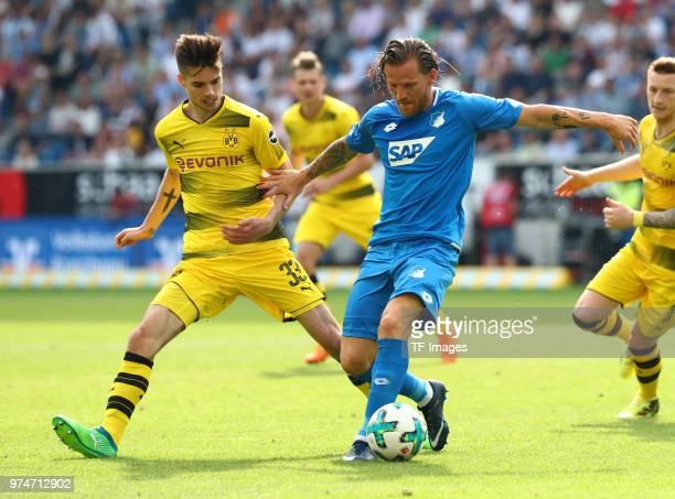 Julian Weigl of Dortmund and Eugen Polanski of Hoffenheim battle for the ball during the Bundesliga match between TSG 1899 Hoffenheim and Borussia...