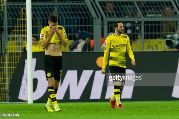 Julian Weigl of Dortmund and Gonzalo Castro of Dortmund looks dejected during the Bundesliga match between Borussia Dortmund and FC Schalke 04 at...