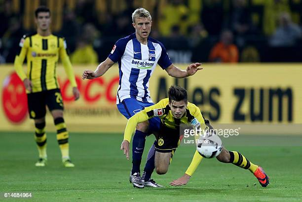 Julian Weigl of Dortmund and Per Skjelbred of Berlin battle for the ball during the Bundesliga match between Borussia Dortmund and Hertha BSC at...