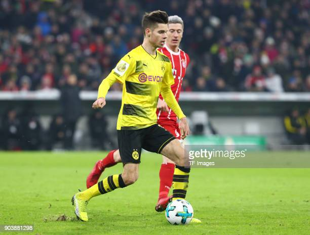 Julian Weigl of Dortmund and Robert Lewandowski of Muenchen battle for the ball during the DFB Cup match between Bayern Muenchen and Borussia...