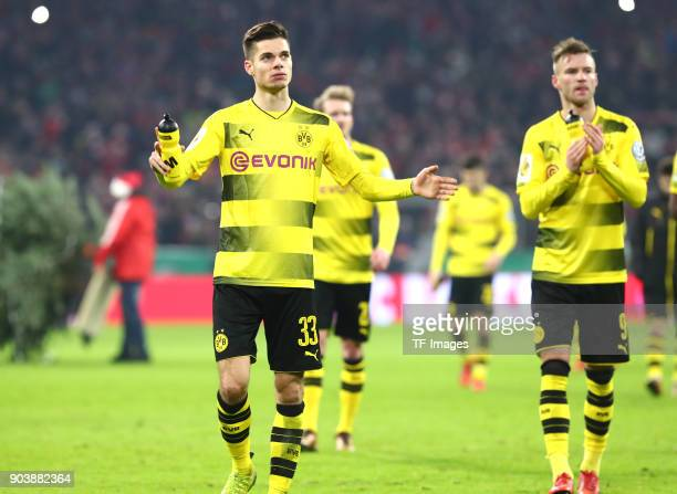 Julian Weigl of Dortmund Andre Schuerrle of Dortmund and Andrey Yarmolenko of Dortmund look dejected after the DFB Cup match between Bayern Muenchen...