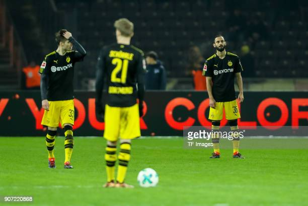 Julian Weigl of Dortmund Andre Schuerrle of Dortmund and Oemer Toprak of Dortmund look dejected during the Bundesliga match between Hertha BSC and...