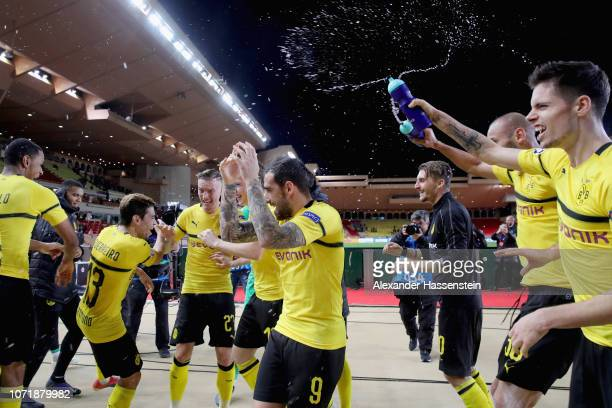 Julian Weigl of Dortmund celebrates victory with his team mates after winning the UEFA Champions League Group A match between AS Monaco and Borussia...