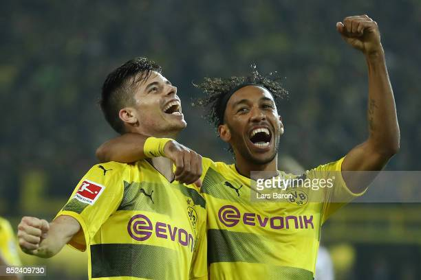 Julian Weigl of Dortmund celebrates with PierreEmerick Aubameyang of Dortmund after he scored his teams sixth goal to make it 61 during the...