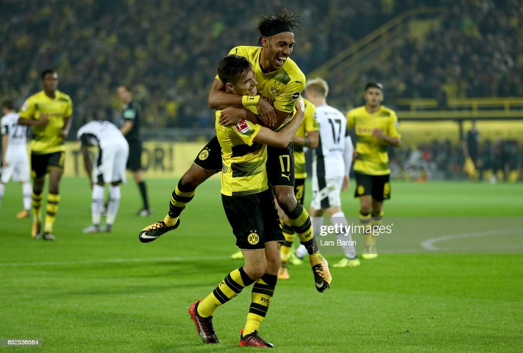 Julian Weigl of Dortmund celebrates with team mate Pierre Emerick Aubameyang of Dortmund after scoring his teams sixth goal during the Bundesliga match between Borussia Dortmund and Borussia Moenchengladbach at Signal Iduna Park on September 23, 2017 in Dortmund, Germany.