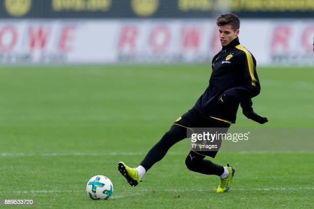Julian Weigl of Dortmund controls the ball during a training session at BVB trainings center on December 7 2017 in Dortmund