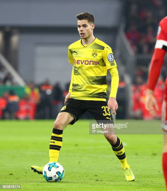 Julian Weigl of Dortmund controls the ball during the DFB Cup match between Bayern Muenchen and Borussia Dortmund at Allianz Arena on December 20...