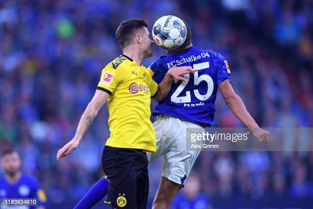 Julian Weigl of Dortmund Head coach Amine Harit of Schalke during the Bundesliga match between FC Schalke 04 and Borussia Dortmund at VeltinsArena on...