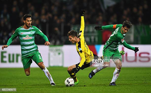 Julian Weigl of Dortmund is challenged by Fin Bartels of Bremen during the Bundesliga match between Werder Bremen and Borussia Dortmund at...