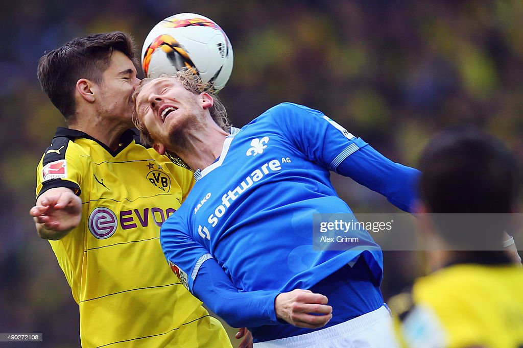 Julian Weigl (L) of Dortmund jumps for a header with Jan Rosenthal of Darmstadt during the Bundesliga match between Borussia Dortmund and SV Darmstadt 98 at Signal Iduna Park on September 27, 2015 in Dortmund, Germany.