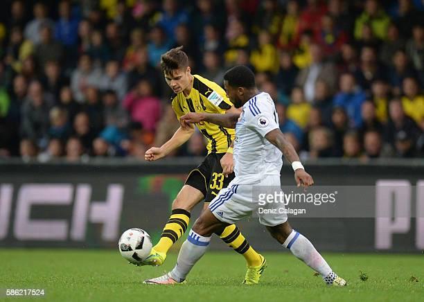 Julian Weigl of Dortmund l9 challenges Jeremain Lens of Sunderland during the friendly match between AFC Sunderland v Borussia Dortmund at Cashpoint...