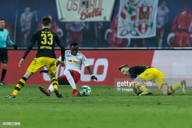 Julian Weigl of Dortmund Marco Reus of Dortmund and Bruma of Leipzig battle for the ball during the Bundesliga match between RB Leipzig and Borussia...