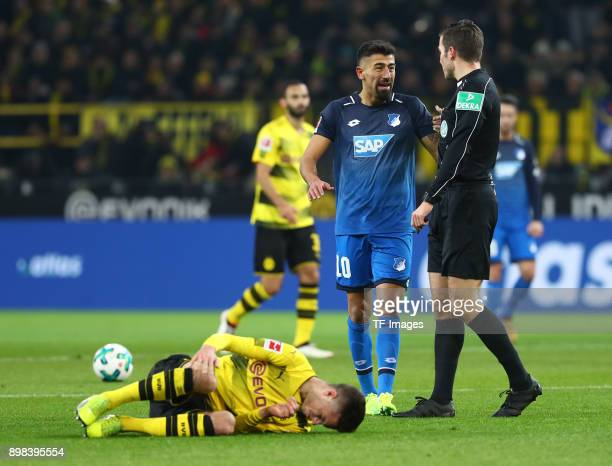 Julian Weigl of Dortmund on the ground and Kerem Demirbay of Hoffenheim speaks with Referee Harm Osmers during the Bundesliga match between Borussia...