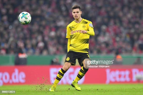 Julian Weigl of Dortmund plays the ball during the DFB Cup match between Bayern Muenchen and Borussia Dortmund at Allianz Arena on December 20 2017...