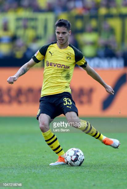 Julian Weigl of Dortmund runs with the ball during the Bundesliga match between Borussia Dortmund and FC Augsburg at Signal Iduna Park on October 6...
