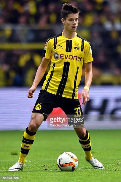 Julian Weigl of Dortmund runs with the ball during the Bundesliga match between Borussia Dortmund and 1 FC Koeln at Signal Iduna Park on May 14 2016...