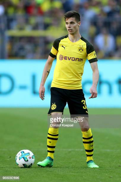 Julian Weigl of Dortmund runs with the ball during the Bundesliga match between Borussia Dortmund and 1 FSV Mainz 05 at Signal Iduna Park on May 5...