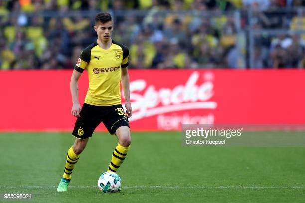 Julian Weigl of Dortmund runs with the ball during the Bundesliga match between Borussia Dortmund and 1 FSV Mainz 05 at Signal Iduna Park on May 5...