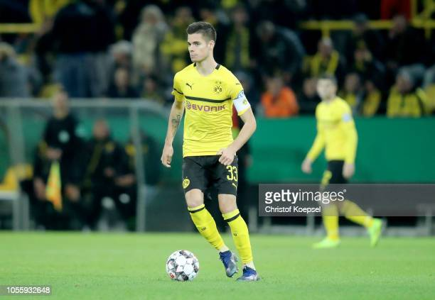Julian Weigl of Dortmund runs with the ball during the DFB Cup match between Borusssia Dortmund and 1 FC Union Berlin at Signal Iduna Park on October...