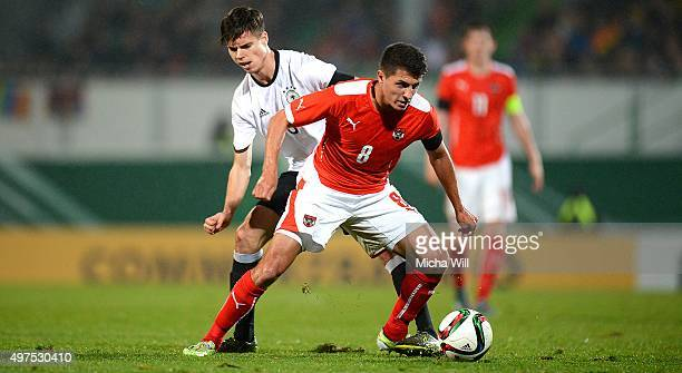 Julian Weigl of Germany and Alessandro Schoepf of Austria compete for the ball during the 2017 UEFA European U21 Championships Qualifier between U21...