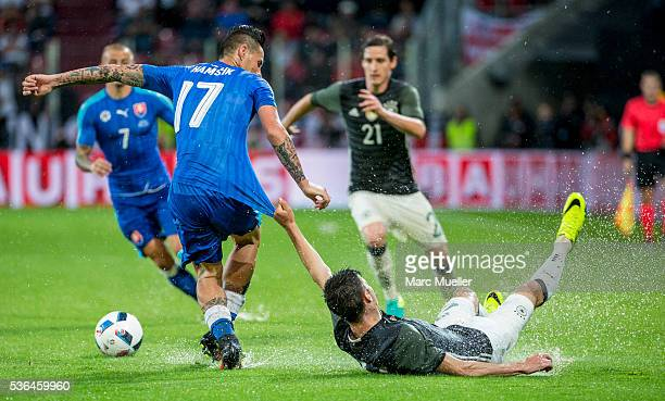Julian Weigl of Germany is challenged by Marek Hamsik of Slovakia during during the international friendly match between Germany and Slovakia at...