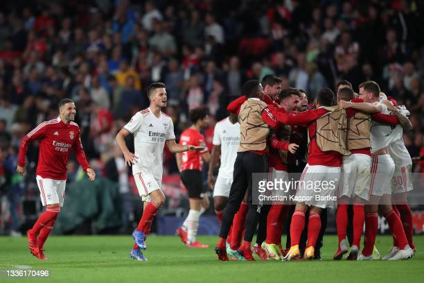 Julian Weigl of SL Benfica celebrates with teammates after the UEFA Champions League Play-Offs Leg Two match between PSV Eindhoven and SL Benfica at...