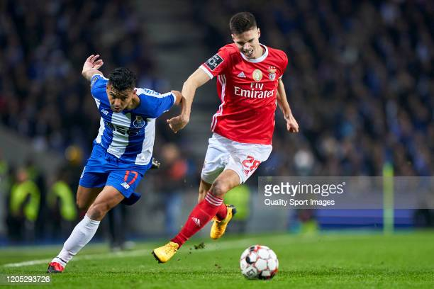 Julian Weigl of SL Benfica competes for the ball with Jesus Corona of FC Porto during the Liga Nos match between FC Porto and SL Benfica at Estadio...