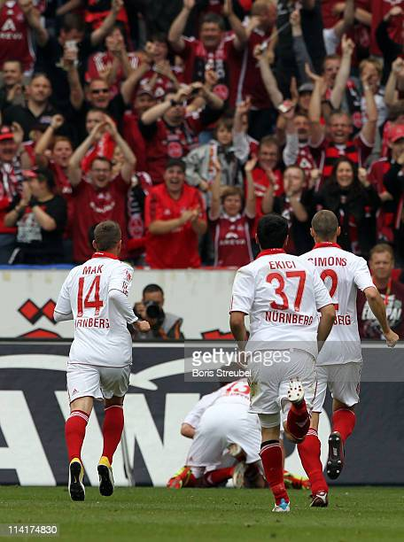 Julian Wiesmeier and his team mates celebrate the first goal during the Bundesliga match between Hannover 96 and 1 FC Nuernberg at AWD Arena on May...