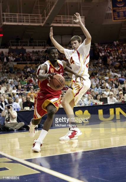 Julian Wright of Chicago Heights IL and Josh McRoberts of Carmel IN play in the McDonalds All American High School Basketball game at the Joyce...