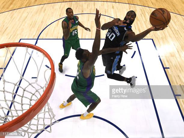 Julian Wright of Power attempts a shot in front of and Larry Sanders and Mario Chalmers of the 3 Headed Monsters during the BIG3 Championship at...