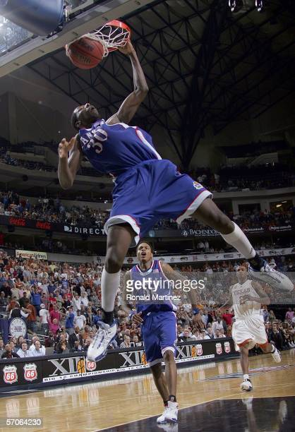 Julian Wright of the Kansas Jayhawks dunks against the Texas Longhorns during the final of the Phillips 66 Big 12 Men's Basketball Championship...
