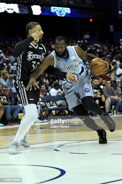 Julian Wright of the Power dribbles the ball while being guarded by Royce White of the Enemies in the first half during week seven of the BIG3 three...