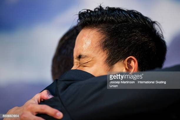 Julian Zhi Jie Yee of Malaysia reacts at the kiss and cry in the Men's Free Skating during the Nebelhorn Trophy 2017 at Eissportzentrum on September...