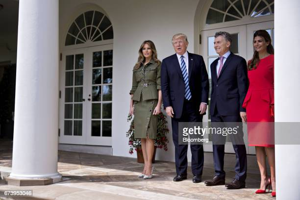 Juliana Awada first lady of Argentina from right Mauricio Macri Argentina's president US President Donald Trump and US First Lady Melania Trump stand...