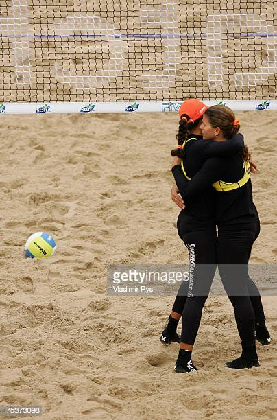 Juliana Felisberta Silva and her team mate Larissa Franca of Brazil celebrate after beating Antje Roeder and Helke Claasen of Germany during the...