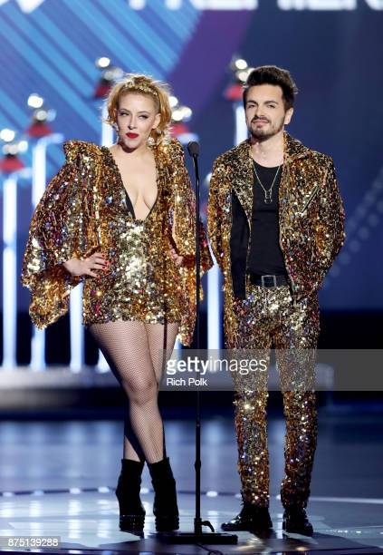 Juliana Gattas and Alejandro Sergi of Miranda speak onstage during the Premiere Ceremony during the 18th Annual Latin Grammy Awards at the Mandalay...