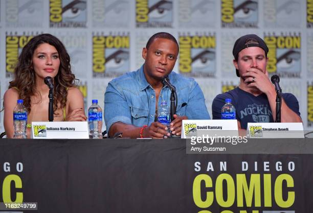 Juliana Harkavy David Ramsey and Stephen Amell speak at the Arrow Special Video Presentation And QA during 2019 ComicCon International at San Diego...