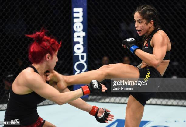 Juliana Lima of Brazil kicks Randa Markos of Iraq in their women's strawweight bout during a UFC Fight Night event at Spectrum Center on January 27...